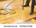 man wearing rubber boots using... | Shutterstock . vector #320661968
