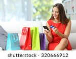 fashion girl buying online with ... | Shutterstock . vector #320666912