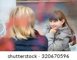 daughter with her mother in a... | Shutterstock . vector #320670596