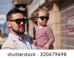 young father walking with tiny... | Shutterstock . vector #320679698