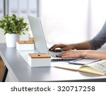 young businesswoman working on... | Shutterstock . vector #320717258
