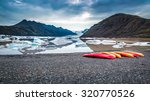 Canoes At Cold Glacial Lake In...