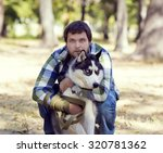 the young man and the siberian... | Shutterstock . vector #320781362