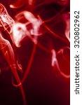 red smoke motion on black... | Shutterstock . vector #320802962