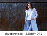 high fashion portrait of young... | Shutterstock . vector #320894042