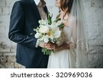 the bride and groom are holding ... | Shutterstock . vector #320969036