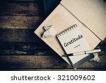gratitude word on pages sketch... | Shutterstock . vector #321009602