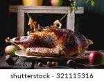 roast stuffed goose on ceramic... | Shutterstock . vector #321115316