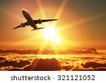 plane takes off at sunrise  | Shutterstock . vector #321121052