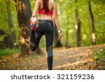 detail of man stretching legs... | Shutterstock . vector #321159236