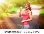 a girl drinks water after sport | Shutterstock . vector #321176492
