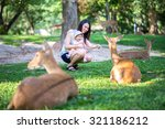 mom and her child in the zoo | Shutterstock . vector #321186212