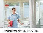 a middle aged nurse in blue... | Shutterstock . vector #321277202