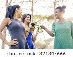 women drinking beer during a... | Shutterstock . vector #321347666