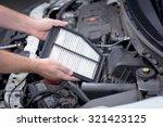 replacing an air filter in a car | Shutterstock . vector #321423125
