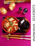 oriental dish with chicken and vegetable stir fry in bowl - stock photo