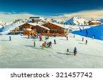 Wooden Chalets And Ski Slopes...