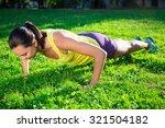 beautiful woman doing push up...   Shutterstock . vector #321504182