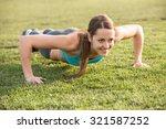 young woman doing pushups...   Shutterstock . vector #321587252