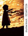 Silhouette Of Little Girl...