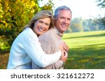 happy senior couple in park.... | Shutterstock . vector #321612272