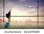 asian man wearing hat carry... | Shutterstock . vector #321649685