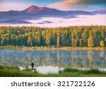 Stock photo two fishermen fishing from the key in high mountain blue lake beautiful yellow autumn forest 321722126