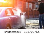 blue car washing on open air | Shutterstock . vector #321790766