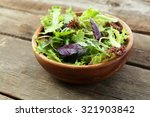 fresh mixed green salad in bowl ... | Shutterstock . vector #321903842