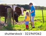 Happy Kids Feeding Cows On A...