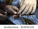white woman holds hands with a... | Shutterstock . vector #322042142