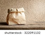 Brown Paper Bag On Wooden...