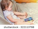 Toddler Girl Watching Cartoons...