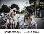 Stock photo two male zombies standing in empty city street looking at camera 322155068