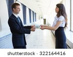 business woman gives money to... | Shutterstock . vector #322164416