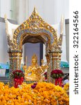 Small photo of BANGKOK, THAILAND - SEPTEMBER 26, 2015: People are paying respect to the Erawan Shrine, which is a Hindu shrine housing a statue of Phra Phrom, the Thai representation of the Hindu creation God Brahma