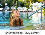 blonde girl in the hotel pool | Shutterstock . vector #32218984