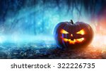Stock photo halloween pumpkin in a mystic forest at night 322226735