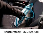 Robber breaking a car's windows to steal a woman bag. - stock photo