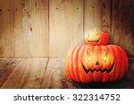 halloween pumpkin on wooden... | Shutterstock . vector #322314752
