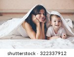 young mother with her 2 years... | Shutterstock . vector #322337912