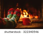 feet in woollen socks by the