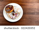 three stacked doughnuts on... | Shutterstock . vector #322420352