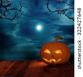 halloween pumpkin on wooden... | Shutterstock . vector #322427648