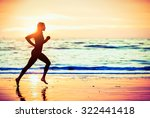 Woman Running On The Beach At...