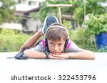 young caucasian boy listening... | Shutterstock . vector #322453796
