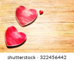 Two Wooden Hearts On A Wooden...