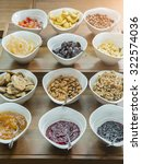 cereals  nuts and jams in bowls ... | Shutterstock . vector #322574036