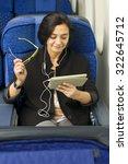 caucasian woman passenger in... | Shutterstock . vector #322645712