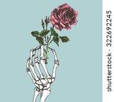 hand skeleton with flower.... | Shutterstock .eps vector #322692245